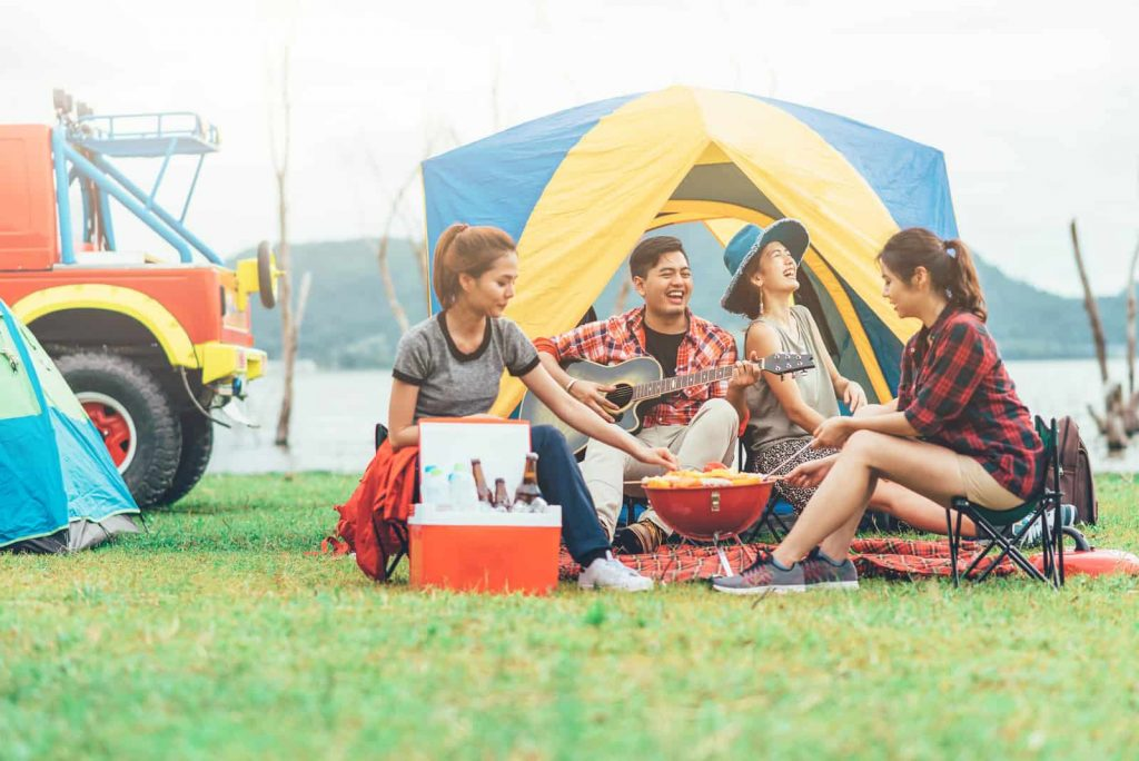 engaging in fun camping activities with friends