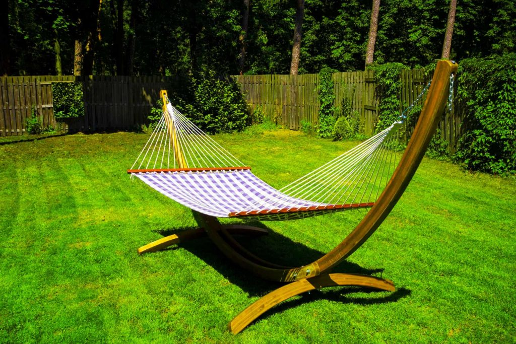 portable hammock stand on the green lawn