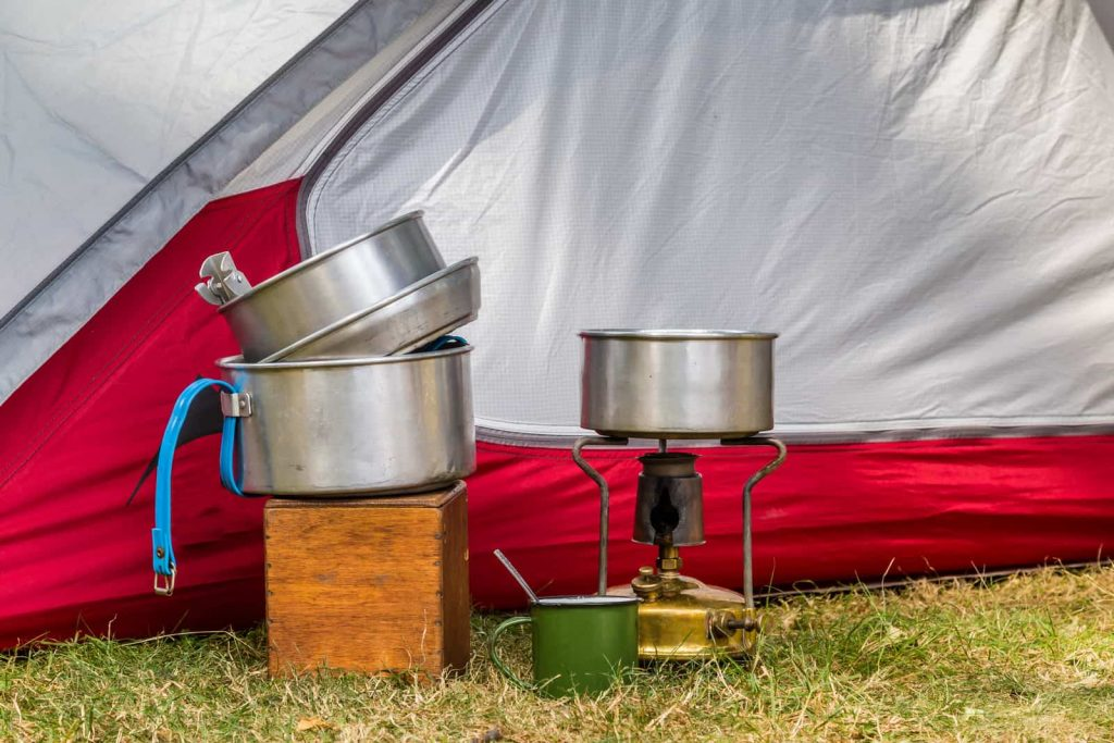 camping mess kit near a tent