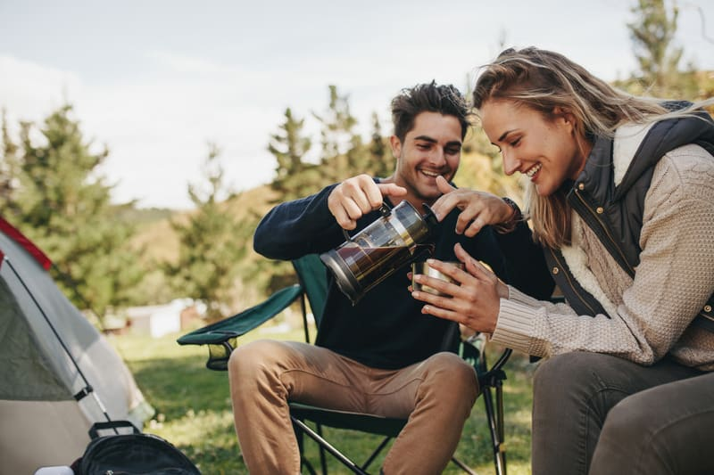 couple with camping tea kettle