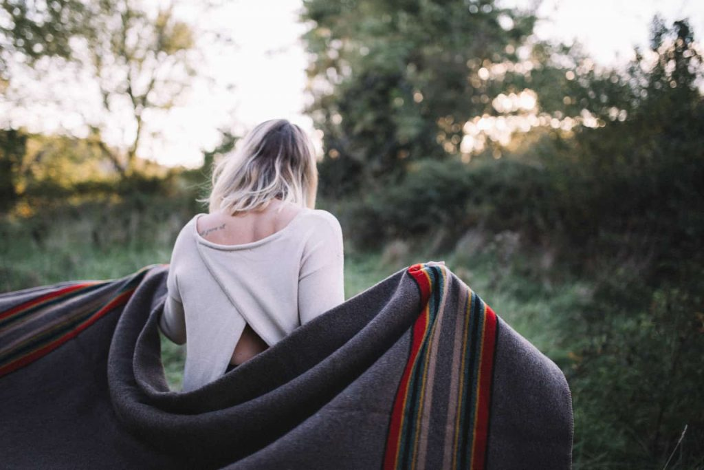 girl with camping blanket