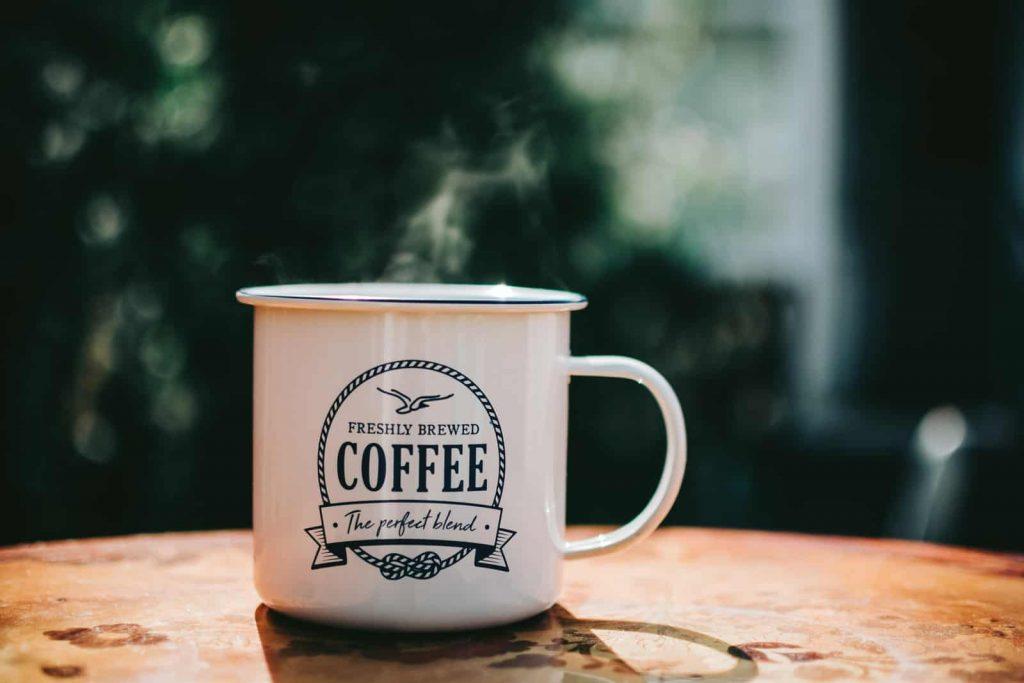 camping coffee mug in the table