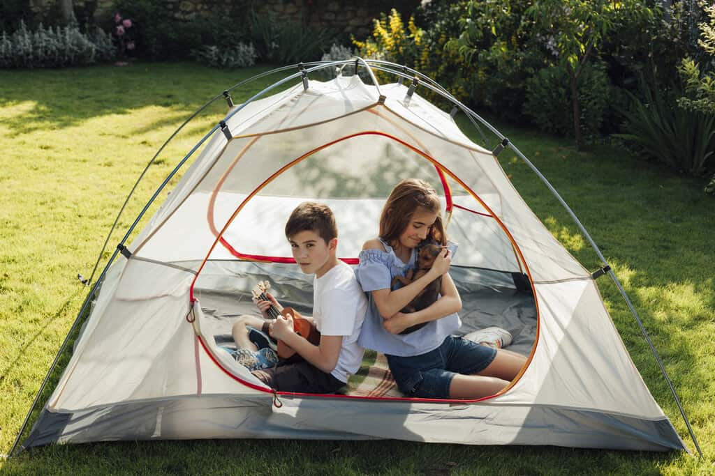 camp in backyard with kids